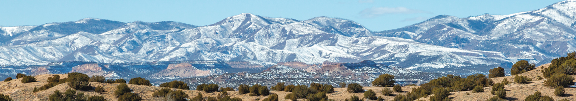 photo of new mexico mountain range covered with snow.