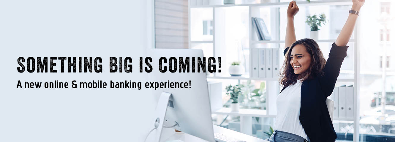 Something big is coming! A new online & mobile banking experience!  Young woman celebrating while online.